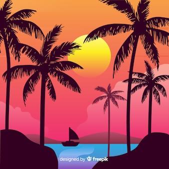 Por do sol da praia com fundo das silhuetas da palma