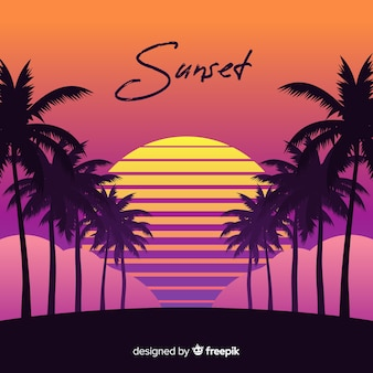 Por do sol da praia com silhuetas da palma