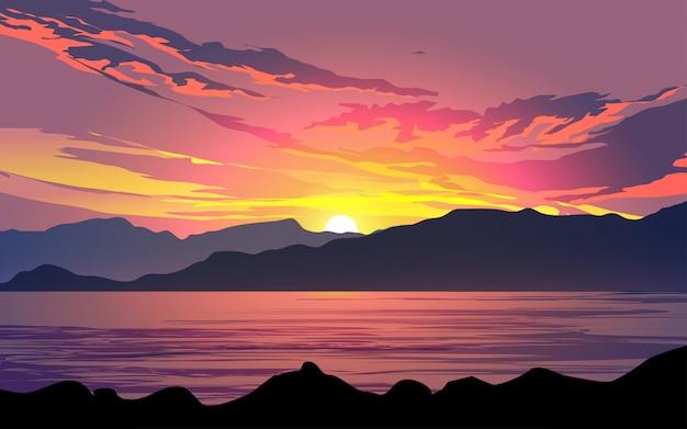 Pôr do sol e crepúsculo sobre as colinas com lago