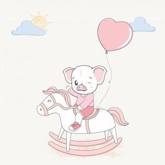 Porco bonito dirigir um cavalo de balanço com balões