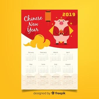 Porco com calendário de ano novo chinês de flores