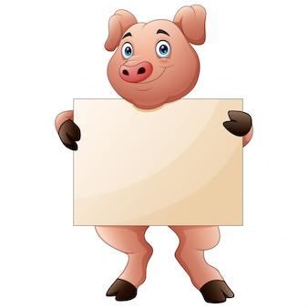 Porco dos desenhos animados segurando cartaz em branco com as duas mãos