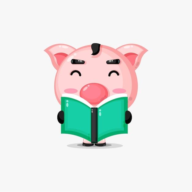 Porco fofo lendo um livro