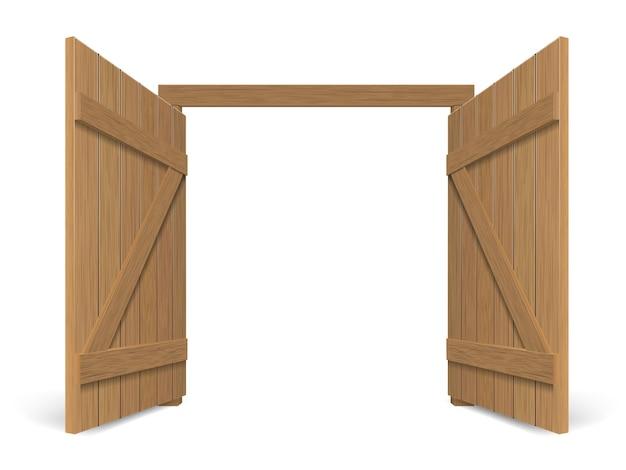 Portão aberto maciço de madeira velho. porta dupla com puxadores e dobradiças em ferro.