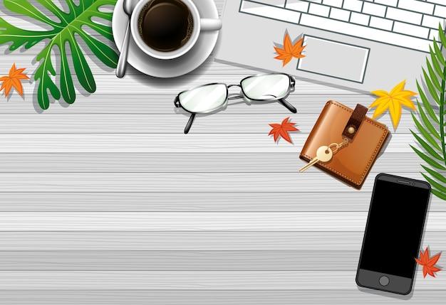 Posição plana da mesa de trabalho de escritório com elementos de escritório com folhas verdes