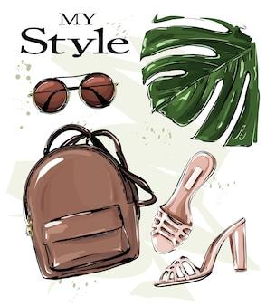 Posição plana definida com óculos de sol de sapatos de mochila