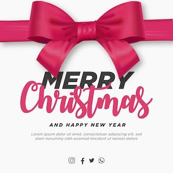 Postagem de feliz natal e feliz ano novo com fita rosa realista
