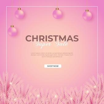 Postagem de venda de natal com fundo rosa ramo de pinheiro rosa e bola de natal