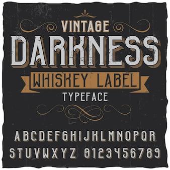 Pôster vintage de whisky escuro com decoração e fita em fonte vintage
