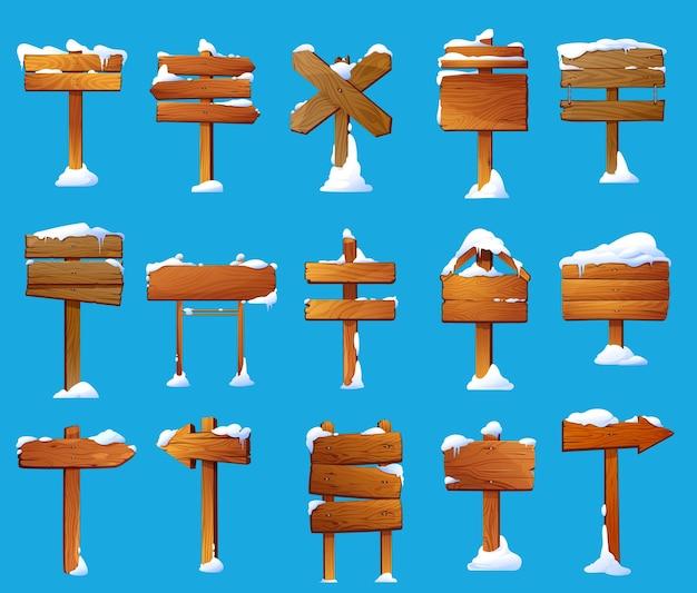 Postes de sinalização de madeira com conjunto de vetores de desenhos animados de neve