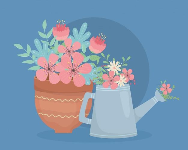 Pote de cerâmica e aspersão com decoração de flores