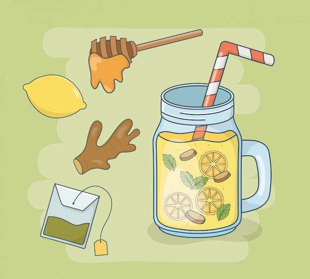 Pote de mel e suco de laranja com palha