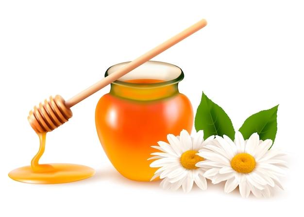 Pote de mel e uma vareta com flor