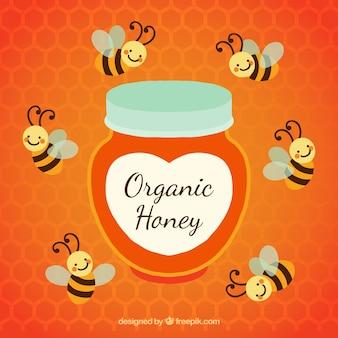 Pote de mel orgânico de abelhas ao redor