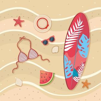Prancha de surf com sutiã maiô e melancia com chapéu