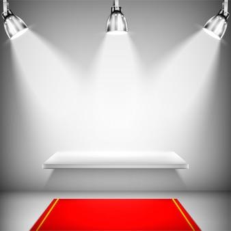 Prateleira iluminada com tapete vermelho