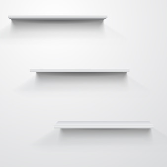 Prateleiras brancas vazias em cinza claro