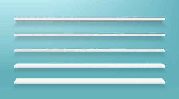 Prateleiras vazias na parede isolada em azul