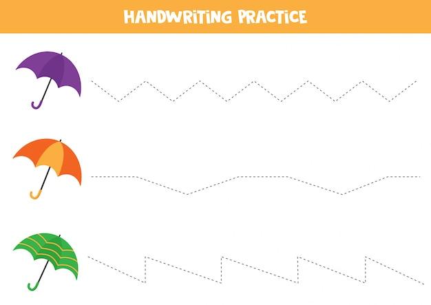 Prática de caligrafia. linhas de rastreamento. conjunto de guarda-chuvas coloridos.