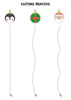 Prática de corte para crianças com bolas de natal bonitos dos desenhos animados.