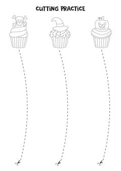 Prática de corte para crianças pré-escolares. corte por linha tracejada. cupcakes de halloween em preto e branco.