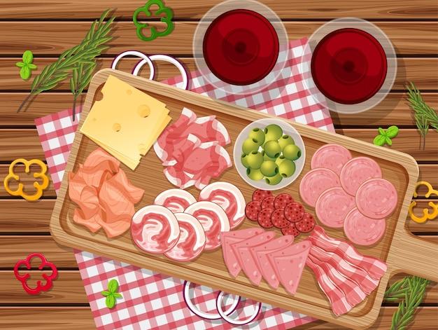Prato de carnes frias e carnes defumadas no fundo da mesa