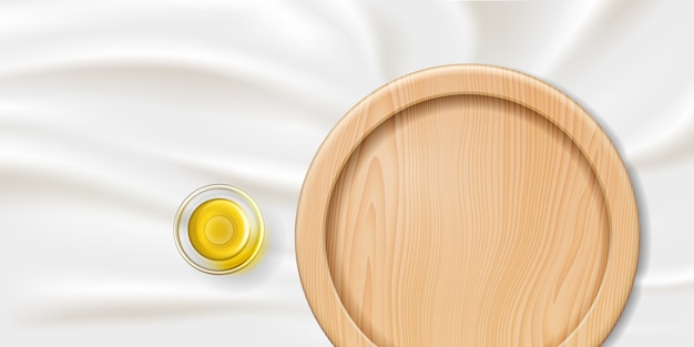 Prato ou bandeja de madeira com óleo de eucalipto em uma tigela ou copo de vidro realista