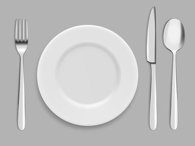 Pratos e talheres. garfo, colher e faca Vetor Premium