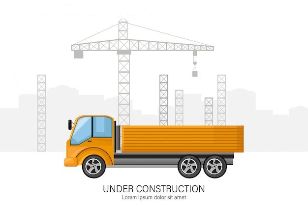 Prédio em construção com caminhão amarelo na frente