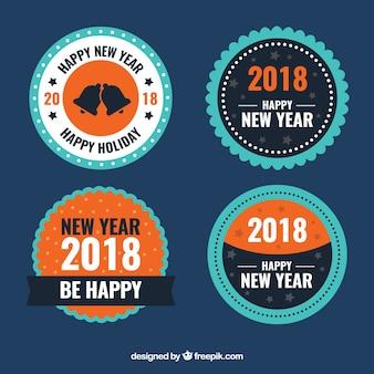 Prêmios redondos do ano novo em azul e laranja