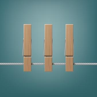 Prendedores de roupa de madeira na vista lateral da corda close up