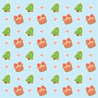 Presente e árvore com padrão de feliz natal