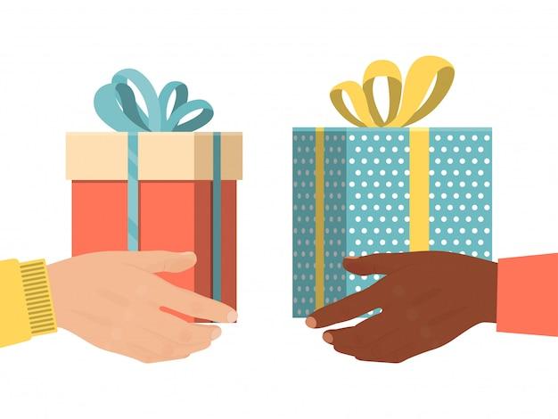 Presente masculino diferente da caixa do presente da posse da mão, lembrança isolada no branco, ilustração do natal. intercâmbio internacional de doações. Vetor Premium