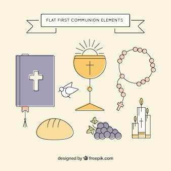 Primeira comunhão com elementos religiosos