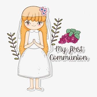 Primeira comunhão menina com uvas e ramos de folhas