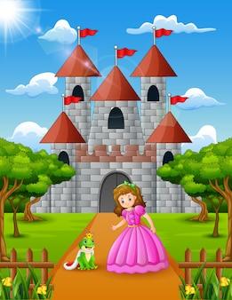 Princesa pequena e príncipe sapo em pé na frente do castelo