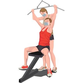 Professora de ginástica ensinando seu membro a usar equipamentos de ginástica
