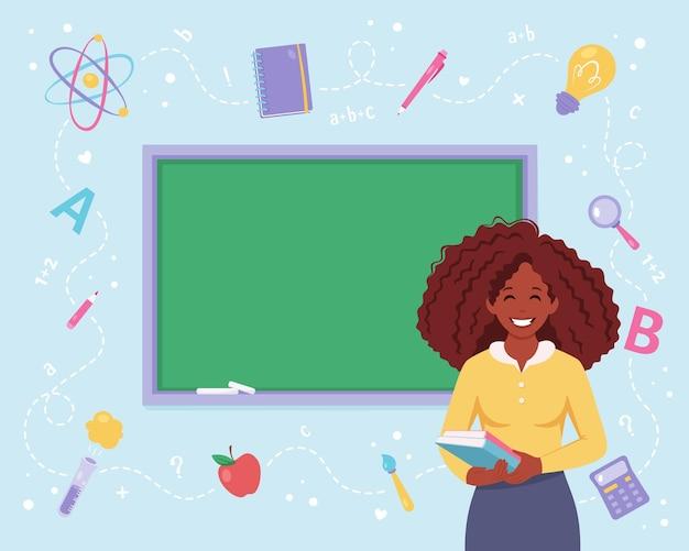 Professora negra em sala de aula com quadro-negro volta para o dia dos professores