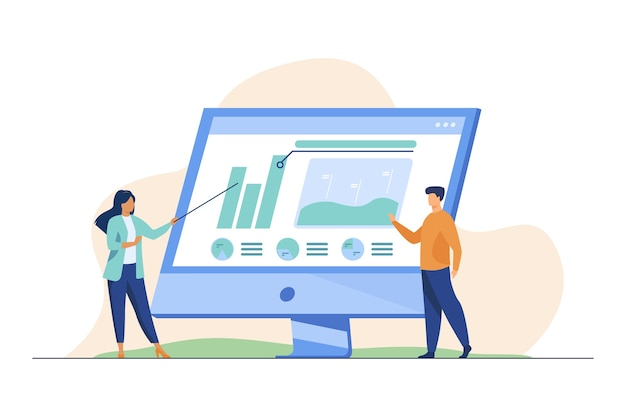 Profissionais que analisam gráficos no monitor do computador.