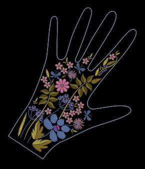 Projeto de bordado de ponto cetim com flores coloridas. linha popular padrão floral na decoração da luva. ornamento de moda étnica para mão em fundo preto.
