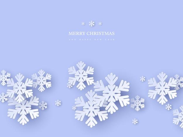 Projeto de férias de natal com flocos de neve de estilo de corte de papel. fundo azul com texto de saudação, plano de fundo