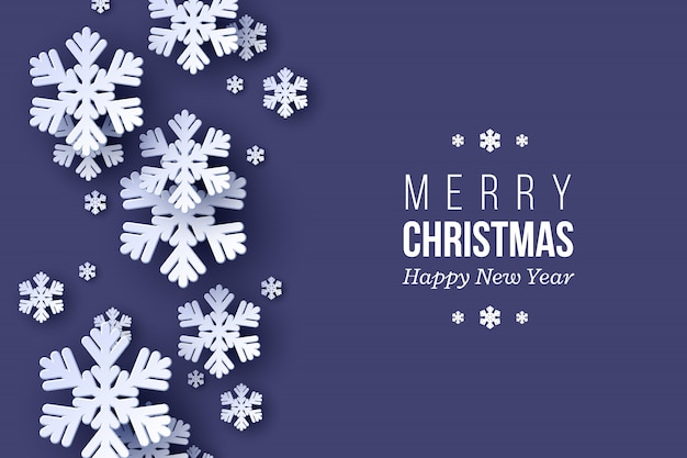Projeto de férias de natal com flocos de neve de estilo de corte de papel. fundo azul escuro com texto de saudação, plano de fundo.