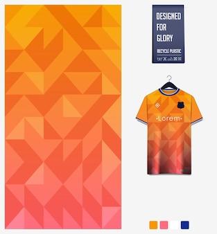 Projeto de padrão de tecido de camisa de futebol padrão abstrato em fundo laranja