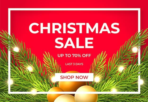 Projeto de venda de natal com galhos de pinheiro, bolas de ouro e lâmpadas.