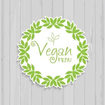 Projeto do menu vegan decorativa com um fundo da textura de madeira