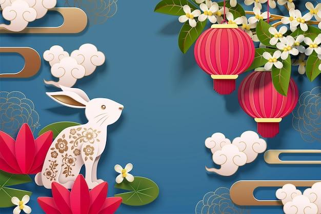 Projeto feliz do festival de meados do outono com coelhos de arte em papel e lanternas vermelhas sobre fundo azul