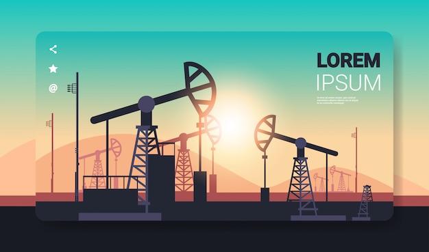 Pumpjack produção de petróleo comércio indústria petrolífera conceito bombas equipamento industrial equipamento de perfuração sunset background horizontal cópia espaço