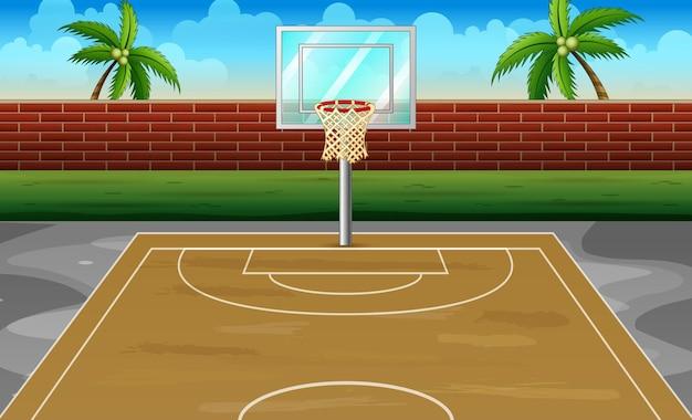 Quadra de basquete ao ar livre com cerca de tijolos