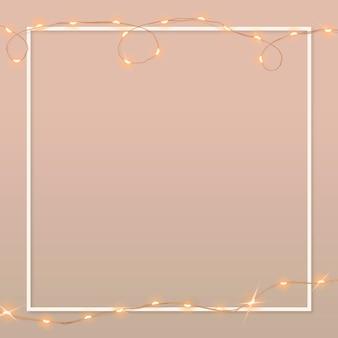 Quadro de borda de luzes com fio em fundo rosa