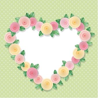Quadro de coração decorado com rosas em bolinhas.